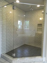 Pebbled shower floors with subway wall tile. Frameless ...