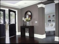 Loving the dark hard wood floors and the color scheme ...