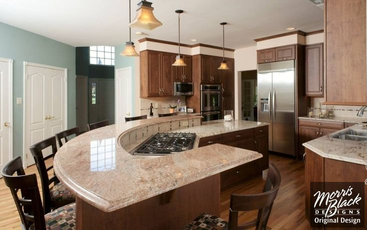 Curved kitchen island strictly reference for multiple heights at counters and angles of