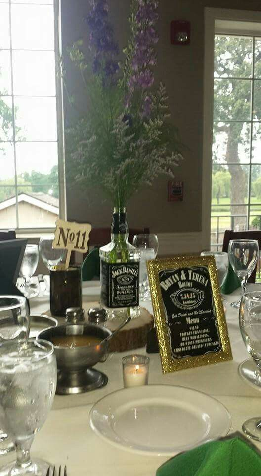 Whiskey bottle centerpieces with wine bottle table numbers