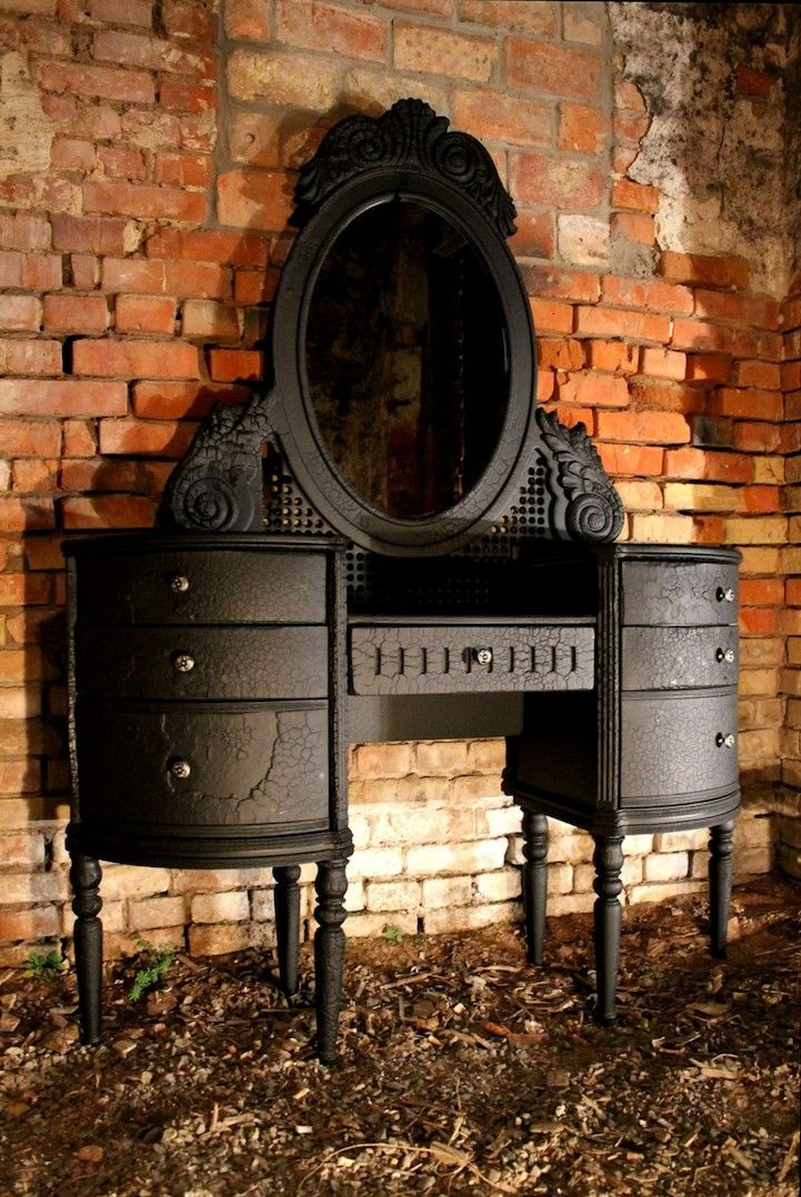 One day, I will have a gorgeous vanity. Course, if this were mine, I would paint it a bright color.