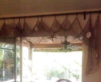 Easy fishing net curtains! @bonniejones128 | Beach decor ...