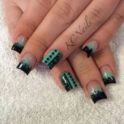 teal and black acrylic nails. two