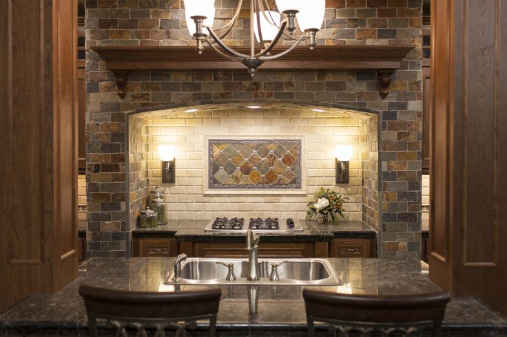 This hearth style backsplash is the focal point of this