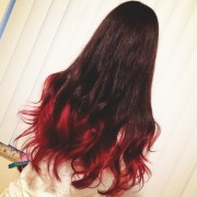 long curly hair. love red ends