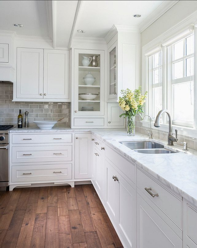 Clean white kitchen, cabinet details at termination: