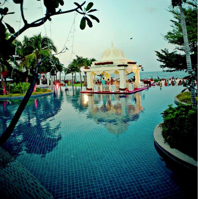 breathtaking rose adorned mandap in a pool overlooking the ocean  wedding decor  Pinterest