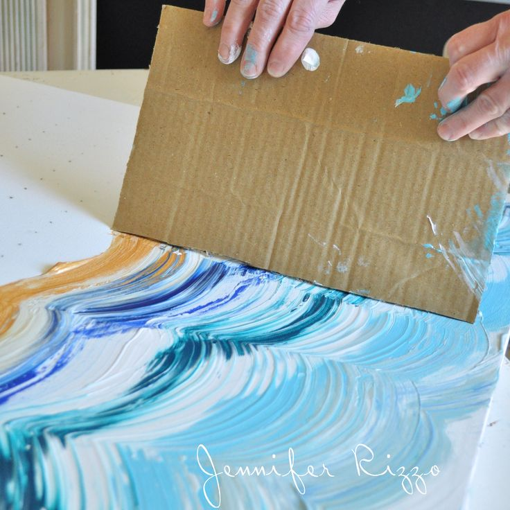 Drag your card board across your paint to make your design- a great way to make a striped or striated patt