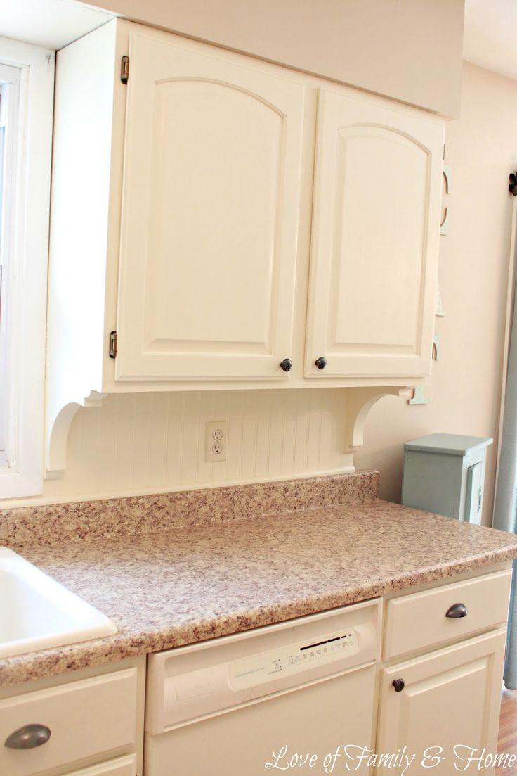 Beadboard Backsplash Kitchen with corbels under cabinets