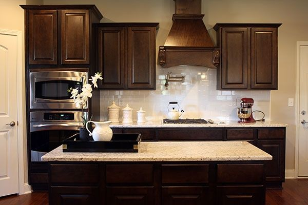 white kitchen cabinets with subway tile backsplash Dark cabinets, white subway tile backsplash, and