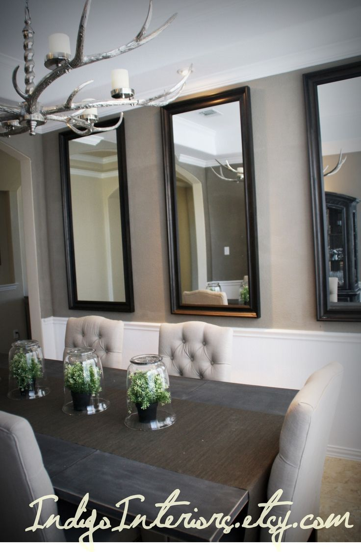 Make a statement in the dining room with three large mirrors hanging vertically  Dining Rooms