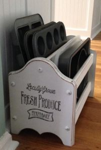wooden magazine rack repurposed to hold cookie sheets