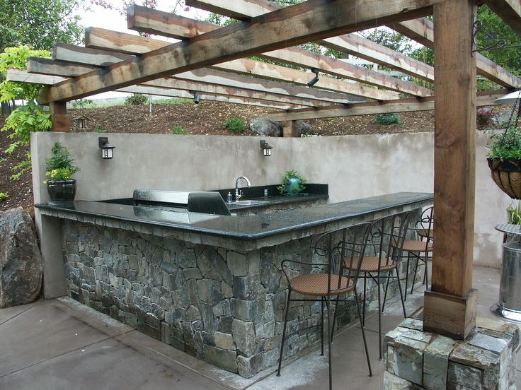 Outdoor Kitchen Cut Into Slope Stone Veneer Finish With