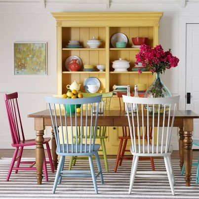 yellow hutch chairs painted different colors  kitchen