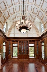 Library with arched, coffered ceiling, chandelier, wood ...