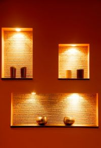 Contemporary lighting against a dramatic red painted wall ...
