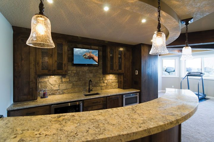 This basement wet bar provides the perfect amount of space