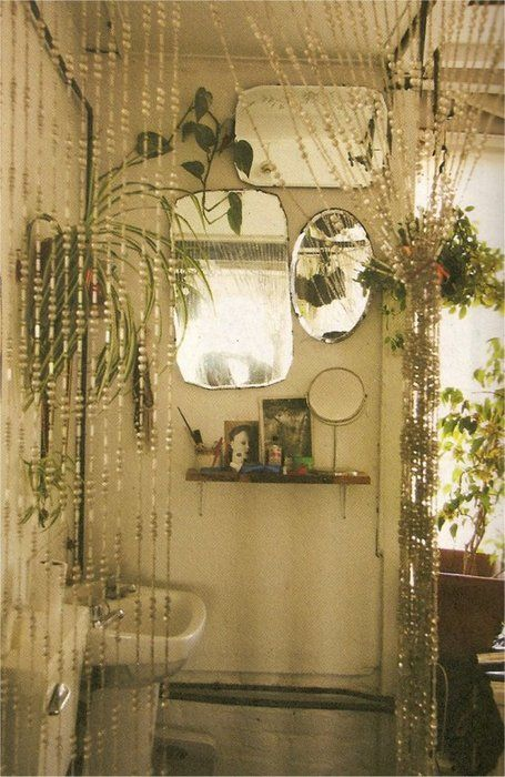 Could hang house plants that like diffused lighting over garden tub in bathroom. Light would reflect off the large mirror, too. Spindles for climbing