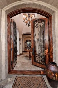 Old World accents at double-door entryway. Simple but ...