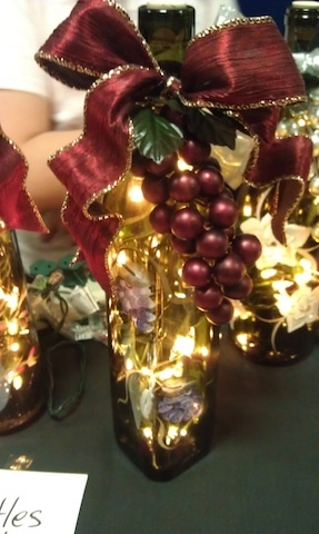 Decorated Wine Bottle With Grapes And Burgundy Bow