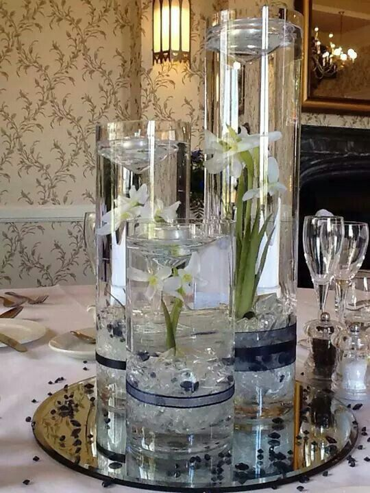 Centre pieces Tiered cylinder vases with floating candles