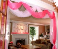 love the clothesline of onesies for decor and pink tulle ...
