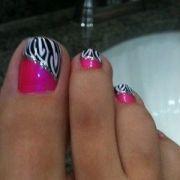 zebra stripe and pink toe nail