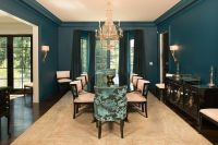 Peacock blue dining room features walls painted peacock