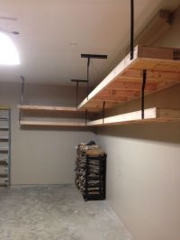 Garage shelves using 2x4s, plywood, and wrought iron ...