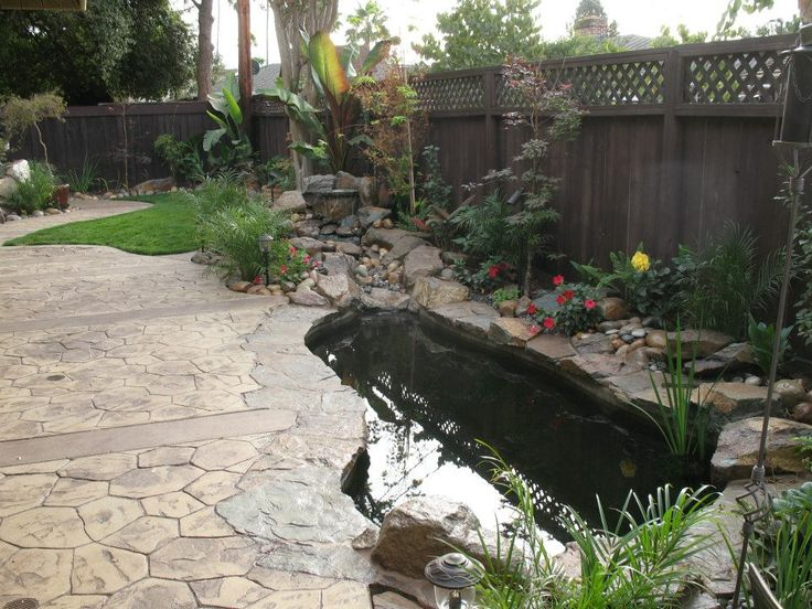 Side Yard Koi Pond With Creek Style Waterfall And Edged In