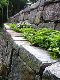 Two tier granite retaining wall built from reclaimed ...