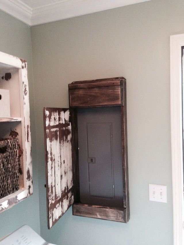 My hubby made this sweet distressed door cover for the