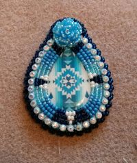 Native American beaded earrings featuring a pear shaped