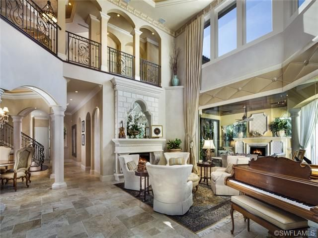 Two Story Formal Living Room With Fireplace Grand Piano Port Royal In Naples FL Naples