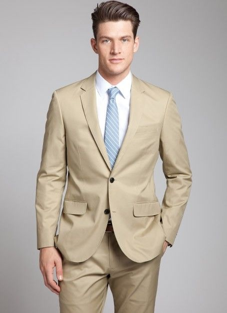 Khaki grooms suit with a blue tie  Wedding Groom