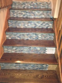 Stone backsplash tile used on stair risers!!