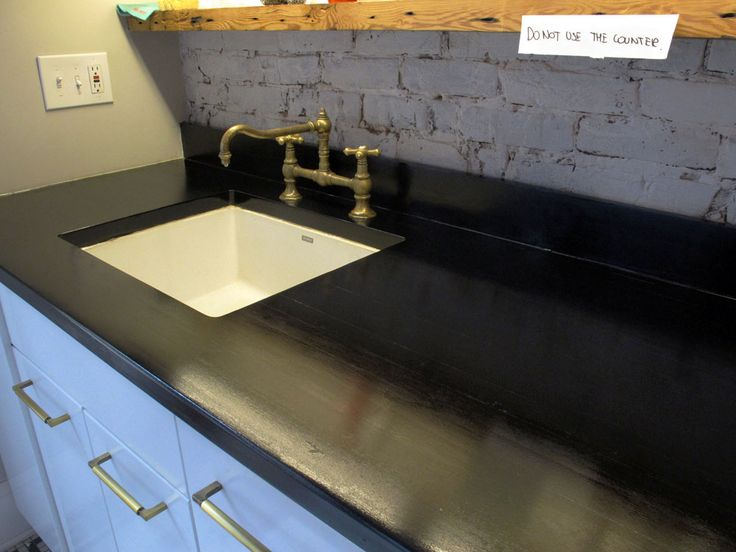 Butcherblock countertop stained black with india ink and