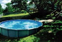 Above ground pool in sloped backyard