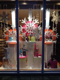 Winter themed window display at liquor store. Styled and ...