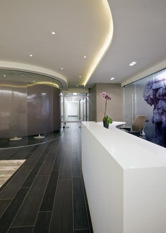 The view from the reception area toward the corridor to all the operating rooms The curved wall