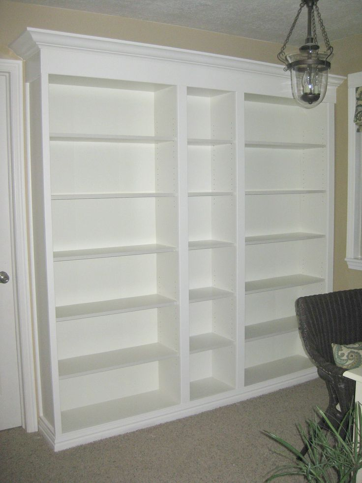 Diy Built Ins With Bookshelves And Mold Trimming At Top