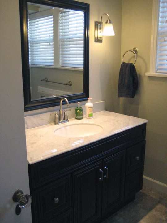 Cherry vanity  carrera marble  sage green walls