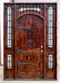 Rustic Exterior Arched Door with Wrought Iron Grills ...