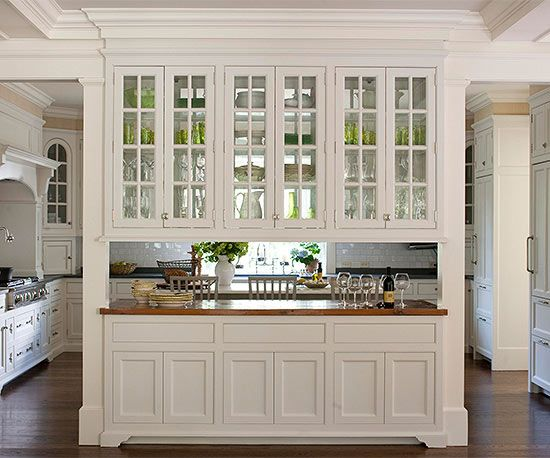 Connect Rooms with a Pass-Through: Here, an opening between the formal dining room and kitchen makes the spaces seem bigger and