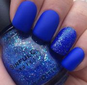 matte royal blue nails with glitter