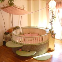 Large round baby crib with lily pad steps and canopy ...