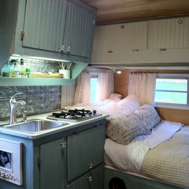 The kitchen and bed area inside the Scotty Hilander I