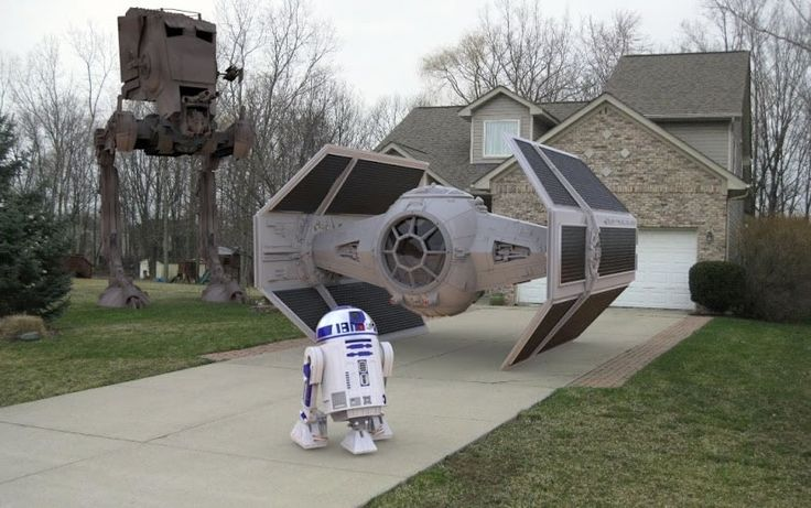 Suburban house with TIE fighter and R2D2 in the driveway