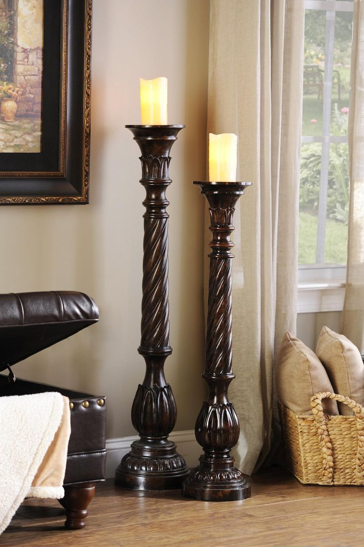 Floor pillar candleholders are a beautiful way to add