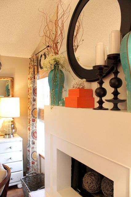 mantel decor large balls in fireplace curtains turquoise and orange color pops  For the Home